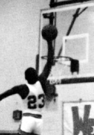 Michael Jordan - Jordan getting ready to slam-dunk for the Laney High School varsity basketball team in 1979–80.