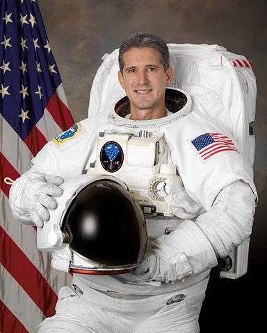 Astronaut Michael T. Good, STS-125 mission specialist, NASA photo (5 Dec. 2007) Source: Wikipedia (spaceflight.nasa.gov killed 25 Feb 2021) 384px-Michaelgoodv2.jpg