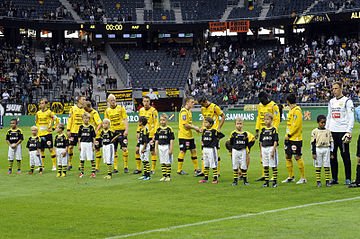 Mjallby AIF players lining up before a 2013 Allsvenskan game. Mjallby AIF lineup v AIK in 2013.jpg