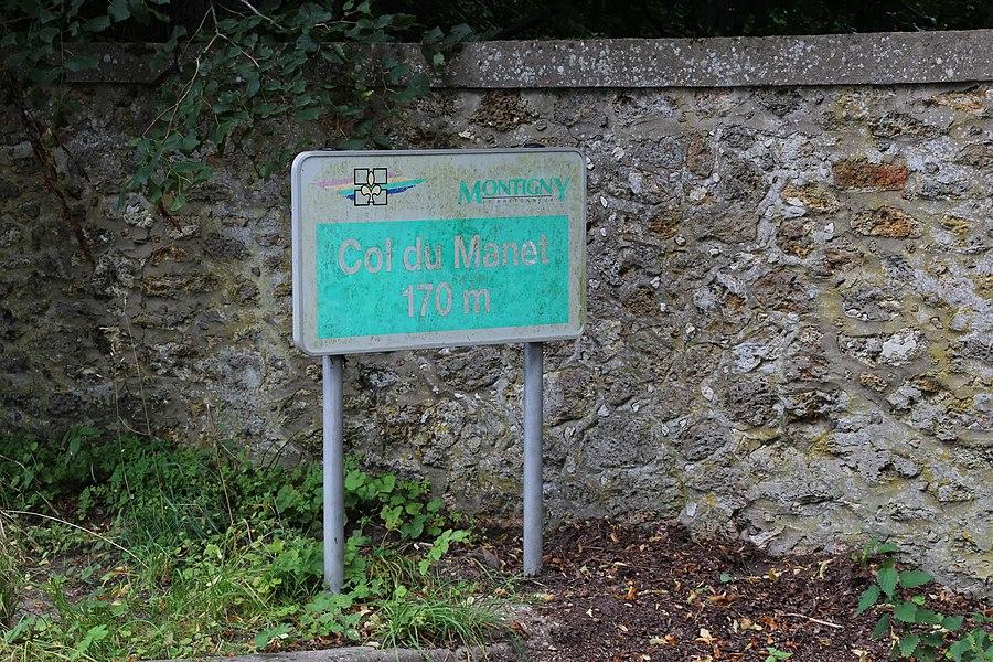 "Erased sign saying ""Col du Manet - 170 m"" at the Manet farm in Montigny-le-Bretonneux, France."