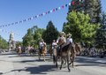Mounted (and buckboard-riding) cowboys and cowgirls ride down Capitol Avenue in one of several parades during the annual Cheyenne Frontier Days celebration in the city of the same name. The Wyoming LCCN2015633184.tif