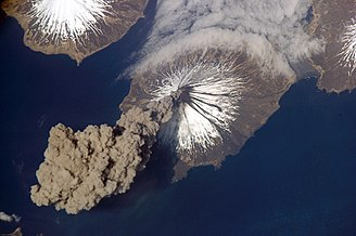 Mount Cleveland (Alaska) - Ash plume arising from Mount Cleveland on May 23, 2006, as seen from the International Space Station. Astronauts were the first to observe the eruption, and alerted the Alaska Volcano Observatory.