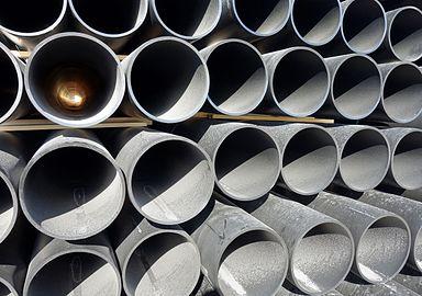 Multiple large dusty black plastic pipes.jpg