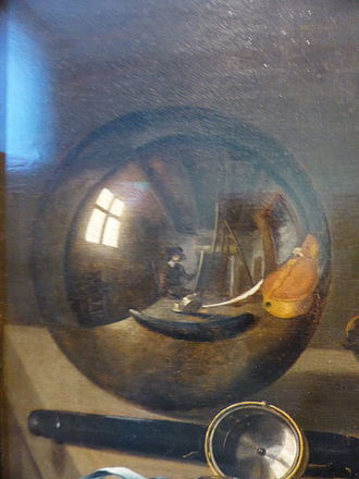 Self-portrait - Pieter Claesz, Vanitas with Violin and Glass Ball (detail), the artist is visible in the reflection, 1625.