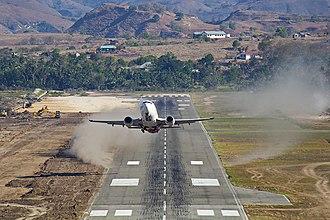 NAM Air - Image: NAM Air Boeing 737 500 taking off from Mau Hau Airport