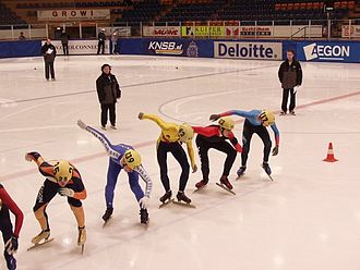 Short track speed skating - Skaters at the starting line.