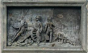 Plaque showing Napoleon sighting a cannon at the Battle of Montereau.