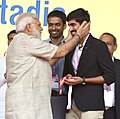 Narendra Modi blesses Indian Badminton player Kidambi Srikanth, at the ceremony to inaugurate the TransStadia Integrated Sports & Entertainment Arena Project & Khel Mahakhumbh-2017, in Ahmedabad, Gujarat.jpg