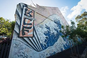 Newtown area graffiti and street art -  BCF: Great Wave Mural Munni/Gowrie St, Newtown, 2000.