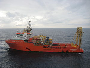Anchor handling tug supply vessel - AHTS Normand Master alongside the ''Balder'' at Thunder Horse Oil Field