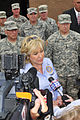 Oklahoma Gov. Mary Fallin, center foreground, speaks with the media while visiting with area residents and Oklahoma National Guardsmen in tornado-damaged Moore 130528-Z-TK779-015.jpg