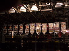 Eleven black, red and white banners, each with an Ottawa Senators logo, the year of a Senators championship win.