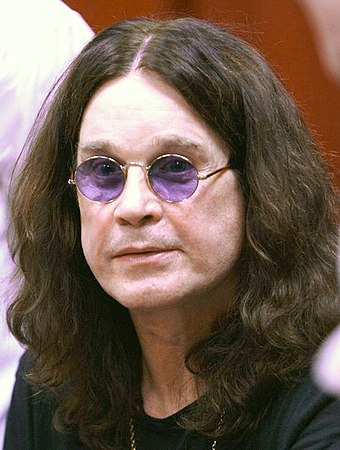 "English singer Ozzy Osbourne has been identified as the ""Godfather of Heavy Metal"" and the ""Prince of Darkness"". OzzyChangingHands02-20-2010.jpg"