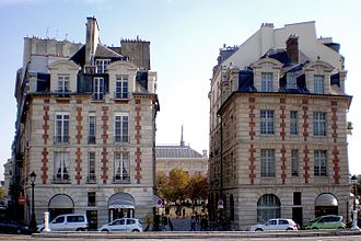 Place Dauphine - Two buildings erected c. 1612, facing the Pont Neuf and flanking the entrance to the Place Dauphine