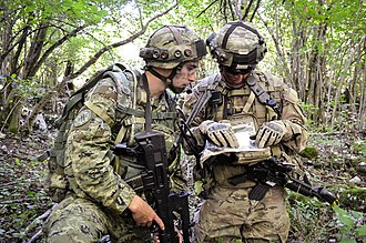 A Croatian Army Soldier works with a U.S. Army Soldier from the 173rd Airborne Brigade in a situational training lane during Immediate Response 15 in Slunj, Croatia. Partner in battle 150914-A-CR001-007.jpg