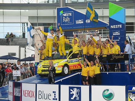P-G Andersson and Suzuki celebrating JWRC class victory at the 2004 Rally Finland. Per-Gunnar Andersson - 2004 Rally Finland.jpg