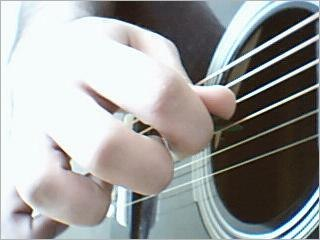 Playing guitar with pick