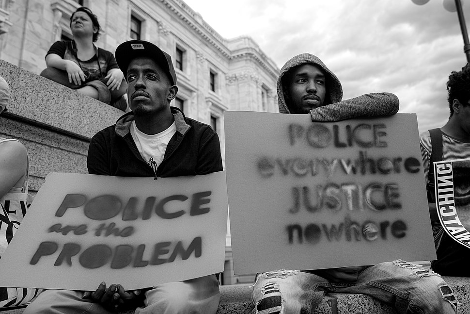 Police Everywhere Justice Nowhere sign at a rally at the State Capitol in St Paul, MN
