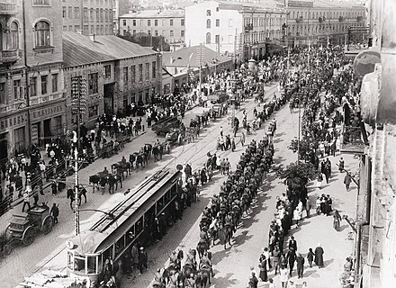 Polish troops enter Kiev in May 1920 during the Polish-Soviet War in which Ukrainians sided with Poland against the Bolsheviks. Following the Peace of Riga signed on 18 March 1921, Poland took control of modern-day western Ukraine while Soviet forces took control of eastern Ukraine. Polish troops in Kiev.jpg