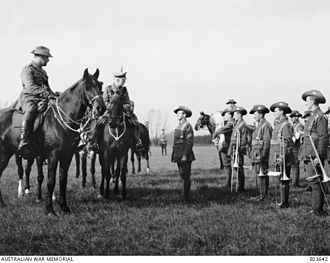 Harold Edward Elliott - Major General Sir Talbot Hobbs, General Officer Commanding the 5th Division, inspecting the 59th and 60th Battalion Bands with Elliott (left)