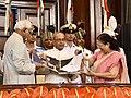 Pranab Mukherjee being presented a coffee-table book by the Vice President and Chairman, Rajya Sabha, Shri M. Hamid Ansari and the Speaker, Lok Sabha, Smt. Sumitra Mahajan, during his farewell ceremony.jpg