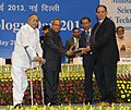 Pranab Mukherjee presenting the National Award for 2013 to Ms BiovetPrivate Limited, Malur, Kolar, Karnataka for successful commercial production of Bluetongue pentavalent vaccine and Johne's disease vaccine.jpg