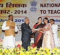 Pranab Mukherjee presenting the National Award for Teachers-2014 to Dr. Geeta Singh, Madhya Pradesh, on the occasion of the 'Teachers Day', in New Delhi. The Union Minister for Human Resource Development.jpg