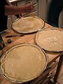 Preparing the pizza dough (78755864).jpg