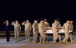 President Barack Obama renders honors as a team of Soldiers carry the remains of Sgt. Dale R. Griffin.jpg