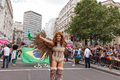 Pride in London 2016 - A drag performer in front of the Brazilian flag.png
