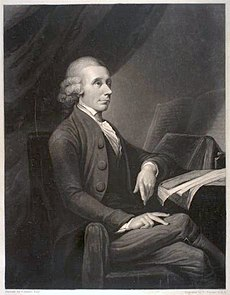 A drawing of an elderly man sitting by a table and facing parallel to the drawing. His left arm rests on a notebook, legs crossed.