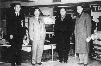 Prince Sedan - Tama Motor Company executives at the exhibition show of the Prince vehicles held at the Bridgestone headquarters in Kyobashi, Tokyo in March 1952. From left to right, Tamotsu Toyama (executive director. Former prototype aircraft workshop manager of Tachikawa Aircraft Company), Satoichiro Suzuki (president), Shojiro Ishibashi (chairman of Tama Motors and the president of Bridgestone) and Kanichiro Ishibashi (executive director. Son of Shojiro Ishibashi).