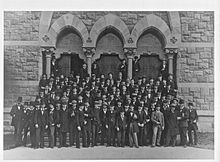 A picture of the Princeton University Class of 1879, posing on the steps of the John C. Green School of Science