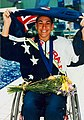 Priya Cooper with medal, posy and flag.jpg