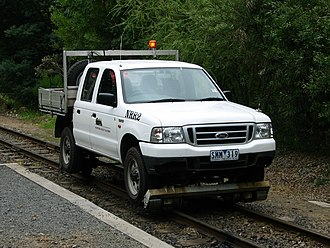 Road–rail vehicle - A Ford Ranger on the Puffing Billy Railway, a self-propelled vehicle that can be legally used on both roads and rails