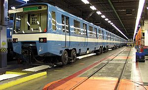 An older generation MR-63 train is in the Beaugrand Garage. Note the turntable to change trucks in the foreground.