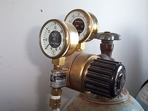 Ceiling balloon - Regulator valve and pressure gauges attached to helium cylinder