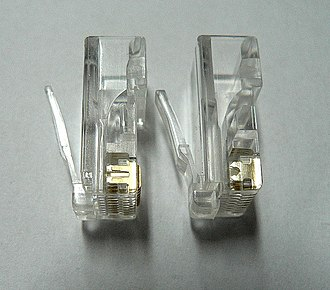 Modular connector - 8P8C plug with contacts for solid wire (left) and stranded wire (right)