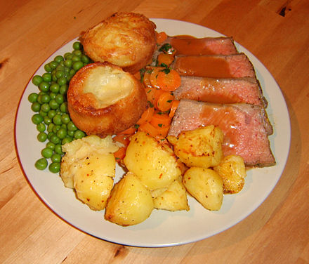 Yorkshire puddings, served as part of a traditional Sunday roast. Roastbeef with yorkshire puddings.jpg