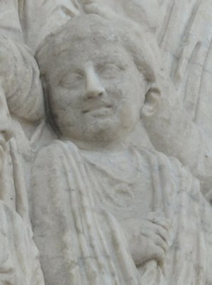 Lunula (amulet) - Detail from the Ara Pacis Augustae showing a Roman girl wearing a lunula.