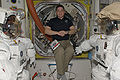 STS-130 Robert Behnken with spacesuits.jpg