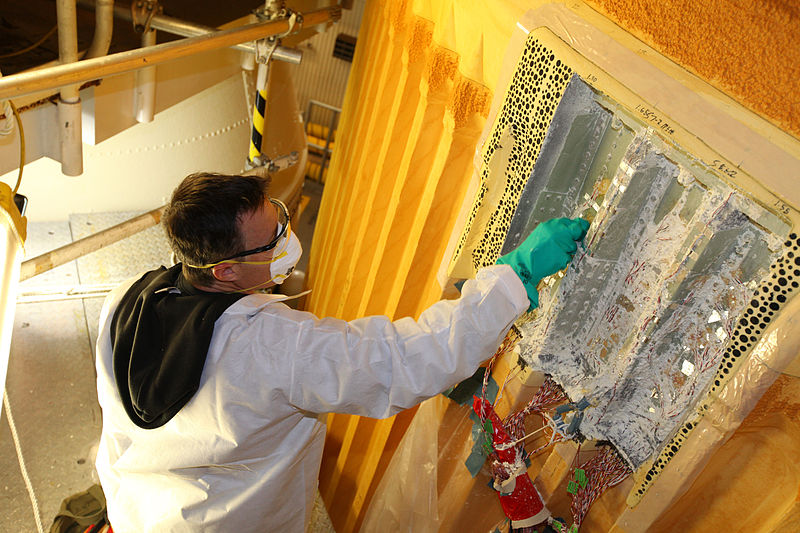 File:STS-133 thermal sensors and foam insulation removing.jpg
