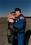STS-72 astronaut Brent Jett greeted by wife.jpg