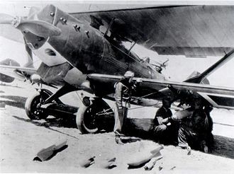 Light bomber - 1937. Turkish air force pilot Sabiha Gökçen inspects her Breguet 19 as it is loaded with bombs.