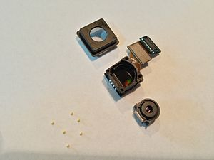 Camera phone - Samsung Galaxy S5 camera, including the floating element group, suspended by ceramic bearings and a small rare earth magnet.