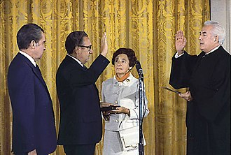 Henry Kissinger - Kissinger being sworn in as Secretary of State by Chief Justice Warren Burger, September 22, 1973. Kissinger's mother, Paula, holds the Bible upon which he was sworn in while President Nixon looks on.