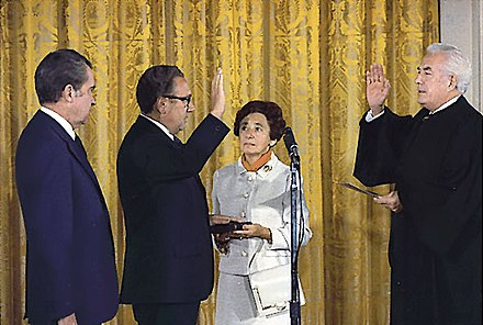 Kissinger being sworn in as Secretary of State by Chief Justice Warren Burger, September 22, 1973. Kissinger's mother, Paula, holds the Bible as President Nixon looks on. Sec of State Kissinger.jpg