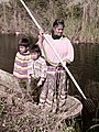 Seminole woman and children gigging frogs near the Tamiami Trail (8452404681).jpg