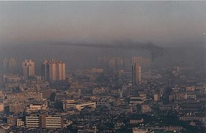 Inversion (meteorology) - Winter smoke in Shanghai, China, with a clear border-layer for the vertical air-spread (1993).