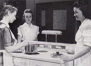 Experiential learning - Shimer College students learning to cook by cooking, 1942.